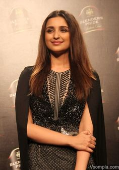 Parineeti Chopra slips into a black dress by Rahul Gandhi + Rohit Khanna and flaunts a centre part hairstyle given to her by Rosario Belmonte. via Voompla.com