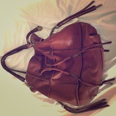 Lucky Brand genuine leather large tote So stylish! Zipper pocket on three sides of bag and a lot of inner pockets too! Objects in last pic for size comparison and not included Lucky Brand Bags Shoulder Bags