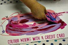 painting with credit cards  Kids squeeze 3 or 4 colors of paint on, then push it around with expired credit card.