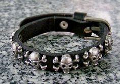 Dark cross leather bracelets with cross bone skeleton metal accessory wristband cuff. $7.99, via Etsy.