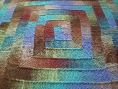 This fun ten stitch knitted blanket is quite unusual in that it has been knitted using only 10 stitches. You knit from the center out in a square spiral.