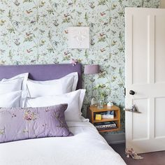 Purple bedroom with country-style bird wallpaper