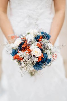 Orange, blue, white, and silver bridal bouquet