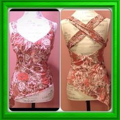 Beautiful top Asymmetric edges, criss-cross back! It is always in style! Beautiful top with all the feminine details! It is new condition..., worn once! Tag says size L but more like a size M!  Venus Tops