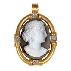 Hardstone Cameo Diamond Gold Pendant c1820.  The carved stone agate cameo depicting a female bust, measuring approximately 43.0 by 30.5 by 16.0 mm (with the frame 65 by 45 mm).  Framed by an oval 18Kt gold mounting with 4 round old-cut diamonds weighing approximately 1.5 carats.