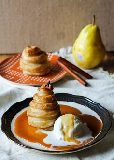 These Apple Cider Poached Pears in Cinnamon Sugar Puff Pastry are easier than you'd think, and use poaching liquid to make a caramel sauce!