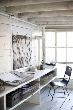 This home office resides in a loft space in a former plow factory from the 1800's. Great light and weathered timbers.