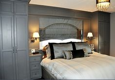 This bedroom was created with the aim of making it welcoming and warm with lots of storage to maintain a neat and clean look. We incorporated built-in storage on either side of the bed to include full-depth 24-inch hanging closet space with nightstands at the standard 26-inch height. This complete unit was painted a muted deep blue-grey colour (Duxbury Grey, Benjamin Moore HC 163).