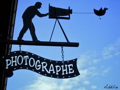 Enseigne d'un photographe, à Arbois, dans le Jura.