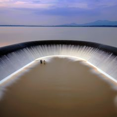 Unbelievable photograph of a dam in Rayong, Thailand, that is used to irrigate crops in the rainy season. The two men are fisherman. Just beautiful! (#thailand)