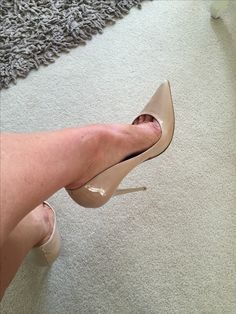 Nude pumps and toe cleavage