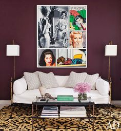 Love the drama and boldness of this artwork.    In the den, the table and daybed are both by Adnet; the painting is by McDermott & McGough, the throw pillows feature a David Hicks fabric custom made by Lee Jofa, and the rug is by Rosemary Hallgarten.