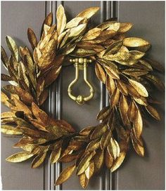 gold magnolia leaf wreath!  must do this...gold spray paint and magnolia leaves