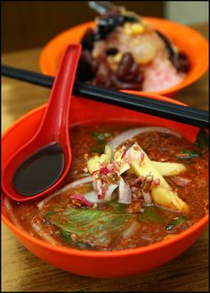 Asam laksa is a sour, fish-based soup. It is listed at number 7 on World's 50 most delicious foods complied by CNN Go in 2011. (x)      Penang laksa (Malay: Laksa Pulau Pinang), also known as asam laksa from the Malay for tamarind, comes from the Malaysian island of Penang. It is made with mackerel (ikan kembung) soup and its main distinguishing feature is the asam or tamarind which gives the soup a sour taste. The fish is poached and then flaked. Other ingredients that give Penang laksa its…