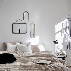 Ditch the headboard and scatter mirrors over your bed for a beautiful, minimal approach to decor