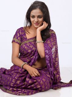 Nithya Menen is an Indian film actress and playback singer, who works in the South Indian film industries. Nithya Menen was born in Banglo. Indian Beauty Saree, Indian Sarees, Oscars Red Carpet Dresses, Purple Saree, Saree Navel, Saree Models, Fancy Sarees, Fashion Poses, Women's Fashion