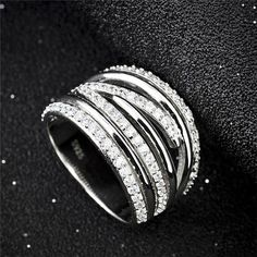 This beautiful sparkling silver ring is individually handcrafted with solid 925 sterling silver and 925 stamped. It features high quality cubic zirconia with Rhodium plated for tarnish resistance and a long lasting mirror finish, a perfect complement for any occasion.