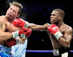 Floyd Mayweather lands a hard right to the face of Arturo Gatti during their…