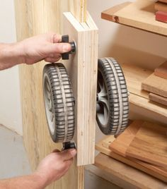 """Plywood Caddy $20 in parts is cheap insurance for your back. Carry plywood by yourself is really a pain. Here's a helper that allows you to roll it around instead. Just clamp this caddy to the board's edge, tip the sheet down onto the wheels and off you go. The caddy will fit plywood that's 1/2"""" to 3/4"""" thick. Its sides aren't glued together—they just slide on bolts. I put …"""