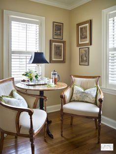 Create an attractive breakfast nook with a cafe table and upholstered chairs.