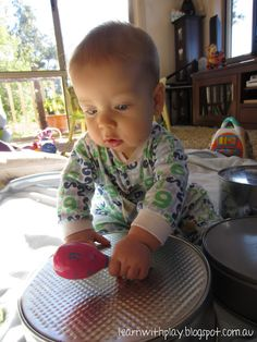 Learn with Play at Home: Baby Play: Rat-a-tat Tins Various cake pans and tins bang with painted wooden spoons!