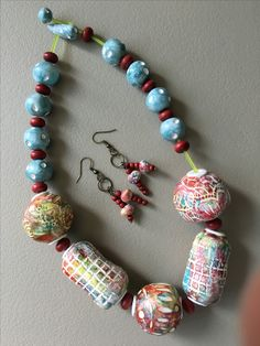 Lyn Tremblay Jewellery Art - created using white polymer clay; coloured with pan pastels; beads are hollow.