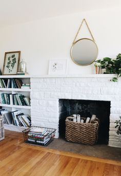Stone Fireplace Makeover: White painted fireplace