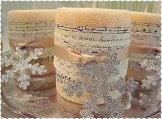 DIY tutorial  PRETTY! - epsom salt candle, sheet music or other paper, lace ribbon, and small snowflake or ornament attached with simple satin ribbon.