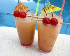 Belize Rum Punch  Ingredients: 2 fluid ounces light rum 1 fluid ounce dark rum 1 fluid ounce orange liqueur 1 fluid ounce sour mix 1 fluid ounce cream of coconut 2 dashes grenadine top with pineapple juice