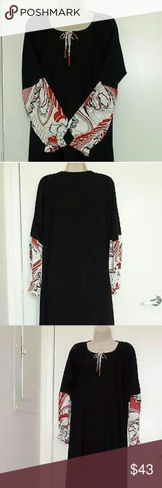 """Kaftan Abaya Jilbab Women Black Dress Womens Long Brand New designed Black Abaya Size Medium With Amira Hijab.  Made from High Quality silky-textured black peach skin Polyester fabric which Does not require ironing.   Please review the measurements carefully: Lain flat  From shoulder to hem- 57 1/2"""" inches = 146 cm.  From armpit to armpit- 22"""" inches = 72 cm.  Slaves from the neckline- 28 1/2"""" inches = 67 cm  Bottom Width- 38 1/2"""" inches = 98 cm   Lightweight for all seasons to wear over…"""