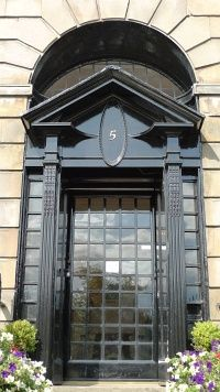 Colour photograph of close-up of front door