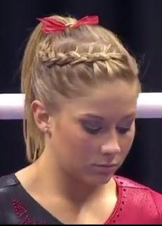 Shawn Johnson's curved side dutch braid into ponytail with bow on Day 1 of Gymnastics Championships 2011.