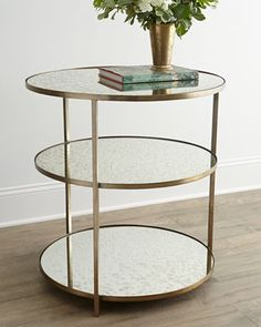 "NM EXCLUSIVE Whitney Mirrored Side TableNM EXCLUSIVE Whitney Mirrored Side Table So unassuming yet so glamorous, this round side table offers three reflective surfaces upon which to display . . . whatever you choose. Made of iron and antiqued, mirrored glass. Antiqued-brass finish. 28""Dia. x 30""T. Imported. Boxed weight, approximately 95 lbs."