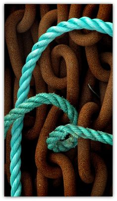 Rusted chain and turquoise rope