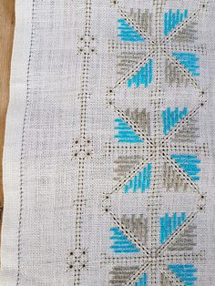 Beautiful turquoise/offwhite embroidered  tablerunner in linen