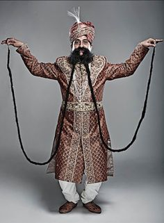 The owner of the world's longest moustache is Ram Singh Chauhan. Ram Singh was recently introduced to Isha Yoga. Beard No Mustache, Moustaches, Record Holder, Guinness World, Guinness Book, Long Beards, World Records, Facial Hair, People