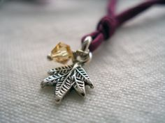 Sterling silver maple leaf charm on wine purple silk yoga necklace by honeywild, $42.00