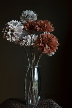 DIY Paper Pom Pom Flowers. See how to @intimateweddings.com #tissuepaperpompoms