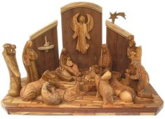 Google Image Result for http://www.gifts-of-faith.com/holyland/olive-wood-elegant-contemporary-nativity-scene-lg.jpg
