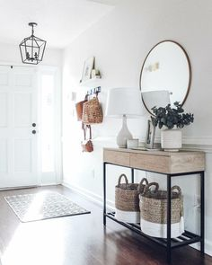 Make the most of your entrance walls with hooks and mirrors. #gyprockliving #ifyourwallscouldtalk #builtforliving #entranceideas