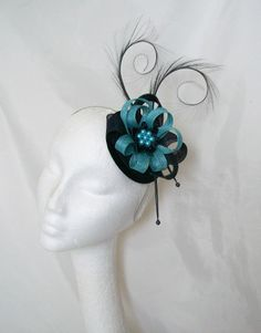 Navy & Turquoise Blue Delilah Fascinator Hat. Order Now from www.indigodaisyweddings.co.uk Specialising in stunning bespoke cocktail fascinators and formal hats in a wide range of colours, perfect for Royal Ascot and The Kentucky Derby. Plus all your wedding floral accessories including shoe clips, vintage flapper bands, feather and flower fascinators, feather fans, fairy wands, wrist corsages, wedding bouquets & buttonholes. Worldwide Delivery.