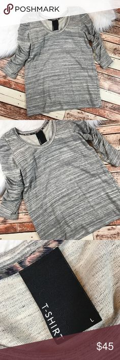 Anthropologie Dolan marled gray ruffle sleeve top Size large in excellent pre owned condition, no flaws! Perfect casual top for the fall! length-27 bust-19.5 pit to pit ::574 Anthropologie Tops Blouses