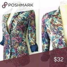 "70s Vintage Feminine Fit Floral Tapestry Blazer Pretty vintage 70s fitted floral tapestry blazer jacket. Cream with blue and purple hues of beautiful floral detail. Breast pocket, and two front pockets, 2 pearlescent front buttons for closure, and fully lined in silky blue acetate. Fitted seams in back for feminine fit. Small shoulder pads built in. Excellent condition.?  Fit for a small:?  14.5"" across shoulder to shoulder seam 36"" bust up to 32"" waist 26"" length 23"" sleeves Vintage…"