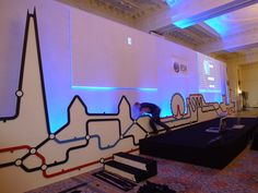 Stage set for a company called RSM.  Looks like the stage set is designed around modified artwork of the London Underground map.