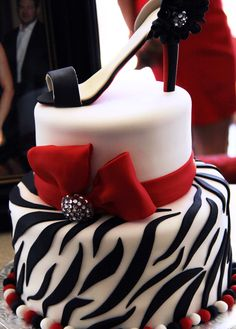 Red Black And White Decor | Oh So Savvy! minus the shoe lol and the zebra and have cheetah! and have a wedding topper on that!