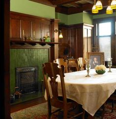 The dining room has a typically masculine look with a high wood wainscot and 'Butchart Green' walls cued by the original fireplace tiles. Arts And Crafts House, Home Crafts, Bauhaus, Restoring Old Houses, Craftsman Interior, Craftsman Style, Craftsman Dining Room, Craftsman Decor, Craftsman Fireplace