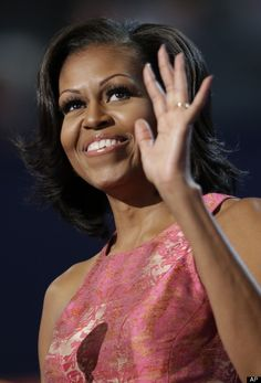 First lady Michelle Obama waves to delegates at the Democratic National Convention in Charlotte, N.C., on Tuesday, Sept. 4, 2012. (AP Photo/David Goldman)