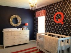Baby Melrose Navy nursery with white crib and hemnes dresser, bright red accents