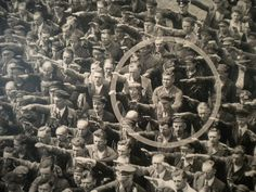 Ordinary people. The courage to say no. The photo was taken in Hamburg in 1936, during the celebrations for the launch of a ship. In the crowd, one person refuses to raise his arm to give the Nazi salute. The man was August Landmesser. He had already been in trouble with the authorities, having been sentenced to two years hard labour for marrying a Jewish woman. We know little else about August Landmesser, except that he had two children. By pure chance, one of his children recognized her…