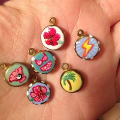 Tropical charms which are akin to  tropical Starbursts but for body adornment not consumption  and still equally  as delish